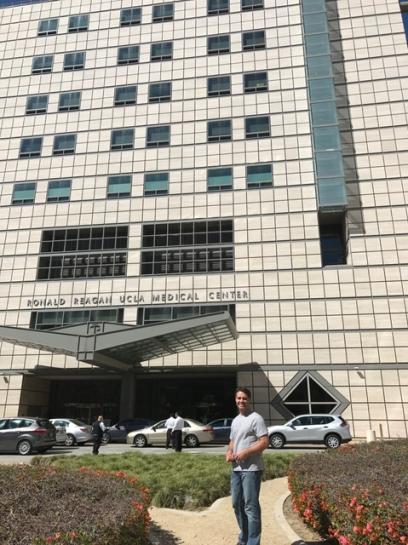 Derek Standing in front of Ronald Reagan Hospital