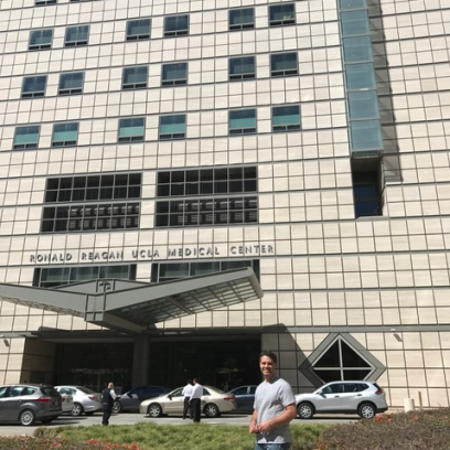 Derek Standing in front of Ronald Reagan Hospital